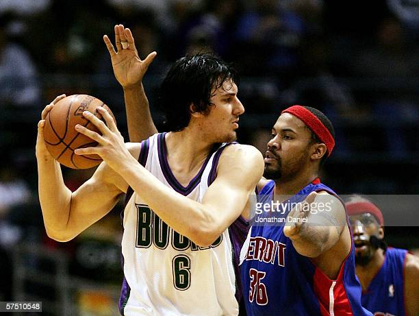 Andrew Bogut of the Milwaukee Bucks is defended by Rasheed Wallace of the Detroit Pistons in Game 4 of the Eastern Conference Quarterfinals during...