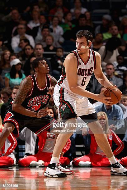 Andrew Bogut of the Milwaukee Bucks looks to pass over Tyrus Thomas of the Chicago Bulls during the game on April 14 2008 at the Bradley Center in...