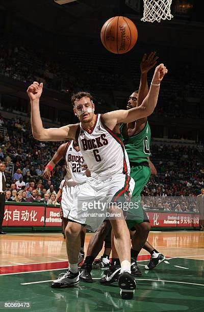 Andrew Bogut of the Milwaukee Bucks looses control of the ball under pressure from Leon Powe of the Boston Celtics on April 8 2008 at the Bradley...