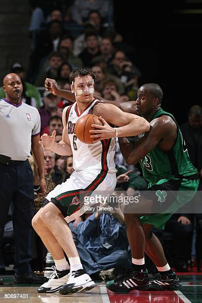 Andrew Bogut of the Milwaukee Bucks makes a move against Kendrick Perkins of the Boston Celtics during the game at the Bradley Center on April 8 2008...