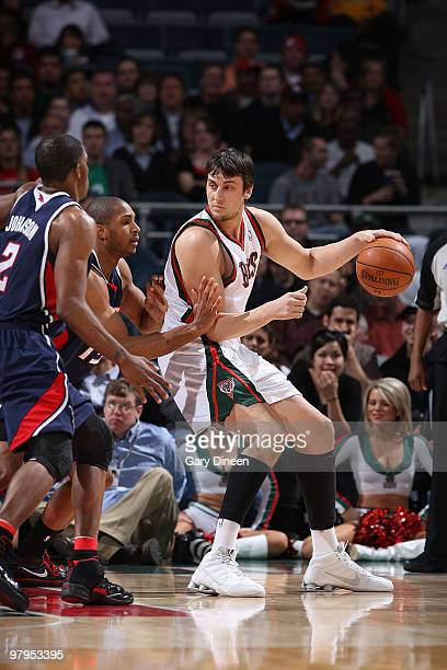 Andrew Bogut of the Milwaukee Bucks posts up against Al Horford of the Atlanta Hawks on March 22 2010 at the Bradley Center in Milwaukee Wisconsin...