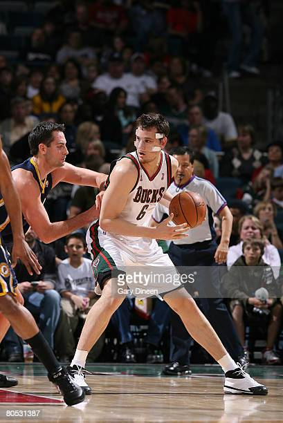Andrew Bogut of the Milwaukee Bucks postsup against Jeff Foster of the Indiana Pacers on April 4 2008 at the Bradley Center in Milwaukee Wisconsin...