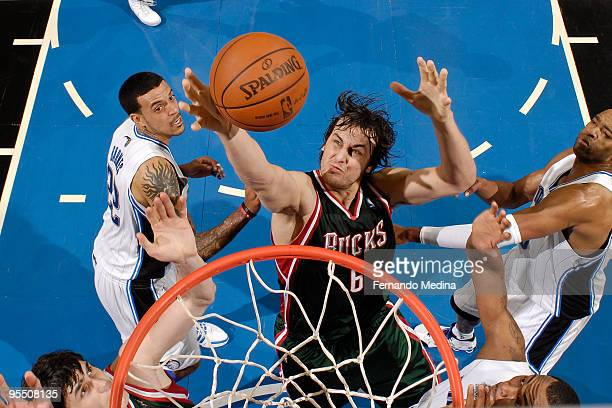 Andrew Bogut of the Milwaukee Bucks reaches for a rebound against the Orlando Magic during the game on December 30 2009 at Amway Arena in Orlando...