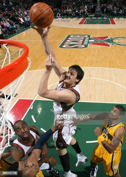 Andrew Bogut of the Milwaukee Bucks shoots a layup against Earl Watson and Danny Granger of the Indiana Pacers during the game at the Bradley Center...