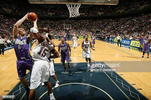 Andrew Bogut of the Milwaukee Bucks shoots against Vince Carter of the New Jersey Nets at Continental Airlines Arena November 2 2005 in East...