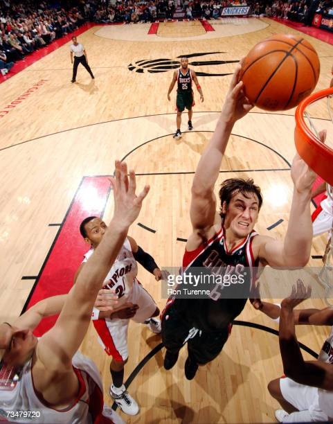 Andrew Bogut of the Milwaukee Bucks takes the ball inside against three members of the Toronto Raptors on March 2 2007 at the Air Canada Centre in...