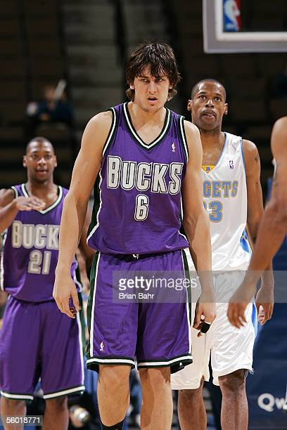 Andrew Bogut of the Milwaukee Bucks walks to the other end of the court against the Denver Nuggets during their preseason game on October 26 2005 at...