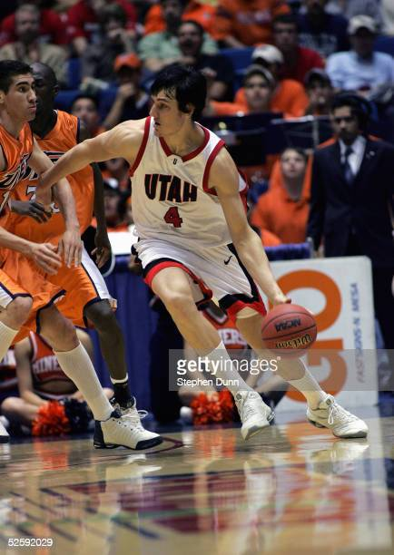 Andrew Bogut of the Utah Utes moves the ball during the game with the UTEP Miners in the first round of the NCAA Men's Basketball Championship on...