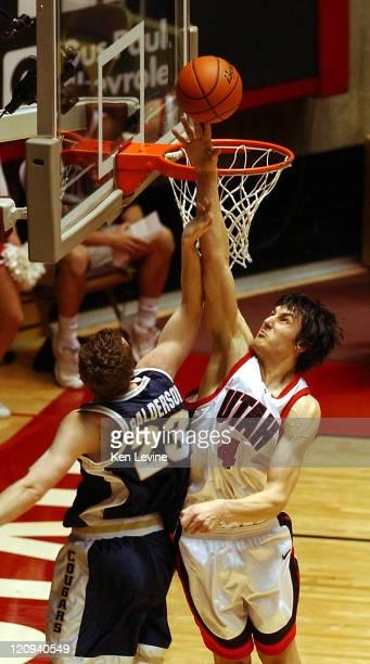 Andrew Bogut of Utah blocks the shot of BYUs Jimmy Balderson during the first half at the Jon Huntsman Center in Salt Lake City Utah Saturday Feb 26...