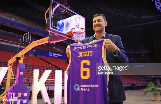 Andrew Bogut poses for photographs with a Kings singlet as he is unveiled as a Sydney Kings player at Qudos Bank Arena on April 24 2018 in Sydney...