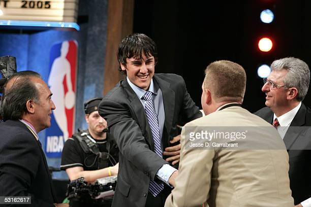 Andrew Bogut shakes hands with family and friends after being selected first overall by the Milwaukee Bucks on June 28 2005 at The Theater at Madison...