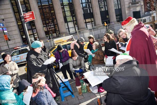 Andrew Bolotowsky with Santa Clause and members of Earth is Our Mother sing Christmas Carols at Petronsino Square as part of 'Make Music Winter...