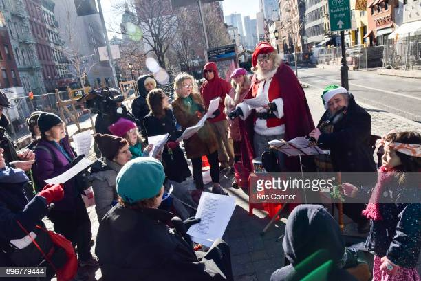 Andrew Bolotowsky with Santa Claus and members of Earth is Our Mother sing Christmas carols at Petronsino Square as part of 'Make Music Winter...