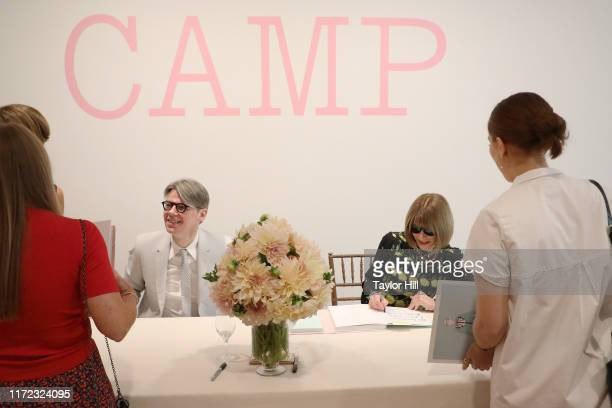 """Andrew Bolton and Anna Wintour autograph copies of the """"Camp: Notes on Fashion"""" exhibition catalogue at Metropolitan Museum of Art on September 04,..."""