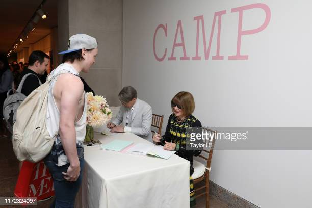 Andrew Bolton and Anna Wintour autograph copies of the Camp Notes on Fashion exhibition catalogue at Metropolitan Museum of Art on September 04 2019...