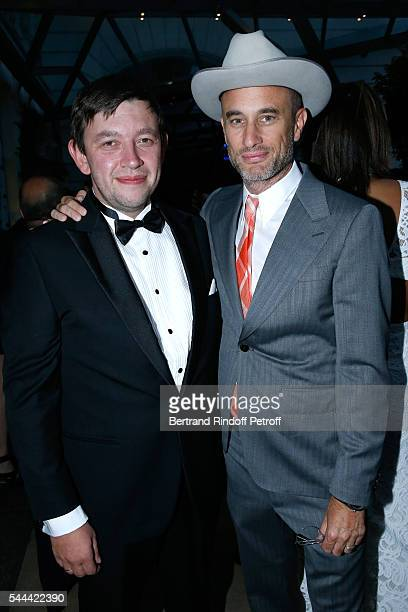 Andrew Boose and guest attend the Amfar Paris Dinner Stars gather for Amfar during the Haute Couture Week Held at The Peninsula Hotel on July 3 2016...