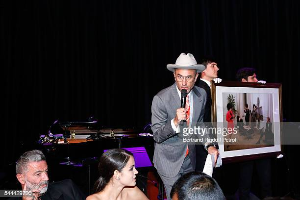 Andrew Boose presents the Auction sale during the Amfar Paris Dinner Stars gather for Amfar during the Haute Couture Week Held at The Peninsula Hotel...
