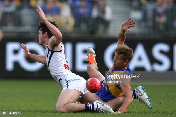 Andrew Brayshaw and Mark LeCras of the Eagles contest for the ball during the round 20 AFL match between the West Coast Eagles and the Fremantle...