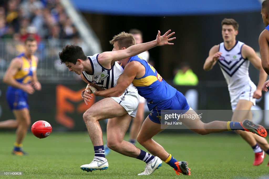 Andrew Brayshaw and Mark LeCras of the Eagles contest for the ball during the round 20 AFL match between the West Coast Eagles and the Fremantle Dockers at Optus Stadium on August 5, 2018 in Perth, Australia.