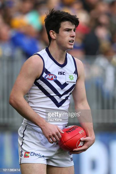 Andrew Brayshaw looks to pass the ball during the round 20 AFL match between the West Coast Eagles and the Fremantle Dockers at Optus Stadium on...