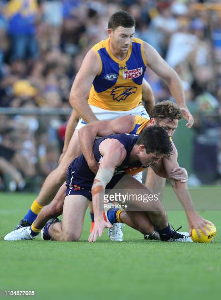 Andrew Brayshaw of the Docker and Mark Hutchings of the Eagles contest for the ball during the 2019 JLT Community Series AFL match between the...