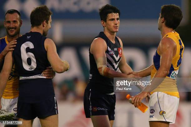 Andrew Brayshaw of the Docker shakes hands with Andrew Gaff of the Eagles following the 2019 JLT Community Series AFL match between the Fremantle...