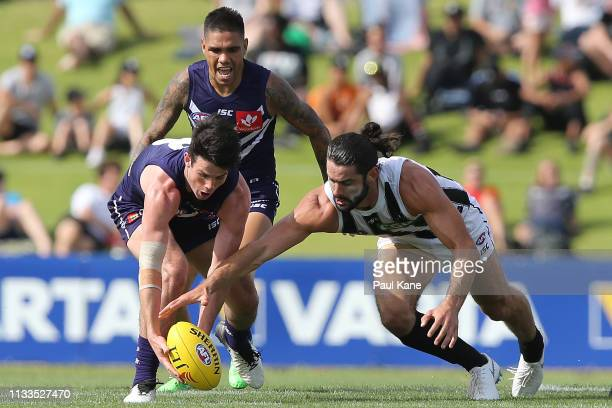 Andrew Brayshaw of the Dockers and Brodie Grundy of the Magpies contest for the ball during the 2019 JLT Community Series AFL match between the...