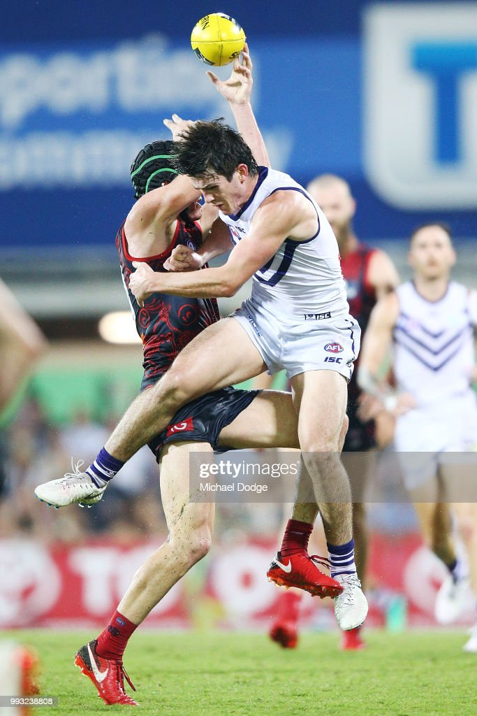 Andrew Brayshaw of the Dockers (R) collides hard with brother Angus Brayshaw of the Demons after a contest during the round 16 AFL match between the Melbourne Demons and the Fremantle Dockers at TIO Stadium on July 7, 2018 in Darwin, Australia.