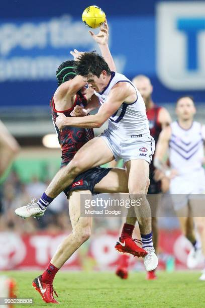 Andrew Brayshaw of the Dockers collides hard with brother Angus Brayshaw of the Demons after a contest during the round 16 AFL match between the...