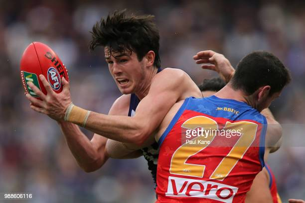 Andrew Brayshaw of the Dockers gets tackled by Darcy Gardiner of the Lions during the round 15 AFL match between the Fremantle Dockers and the...