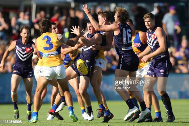 Andrew Brayshaw of the Dockers gets tackled during the 2019 JLT Community Series AFL match between the Fremantle Dockers and the West Coast Eagles at...