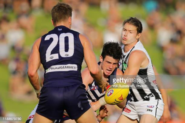 Andrew Brayshaw of the Dockers handpasses the ball under pressure during the 2019 JLT Community Series AFL match between the Fremantle Dockers and...
