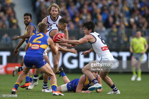Andrew Brayshaw of the Dockers intercepts a handball by Elliot Yeo of the Eagles during the round 20 AFL match between the West Coast Eagles and the...