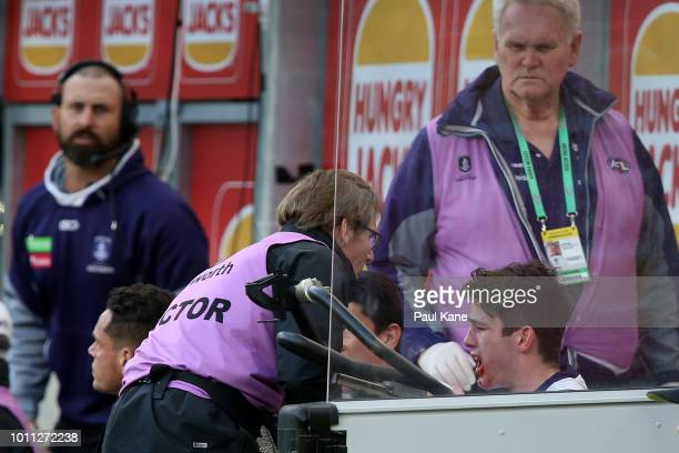 Andrew Brayshaw of the Dockers is checked on the bench after being struck by Andrew Gaff of the Eagles during the round 20 AFL match between the West...