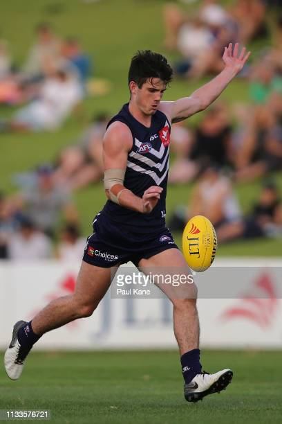 Andrew Brayshaw of the Dockers kicks on goal during the 2019 JLT Community Series AFL match between the Fremantle Dockers and the Collingwood Magpies...