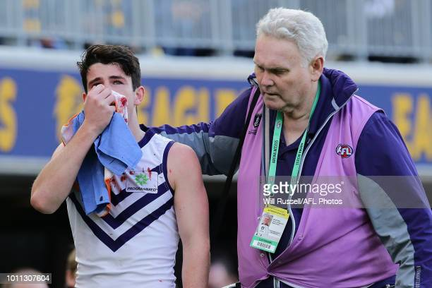 Andrew Brayshaw of the Dockers leaves the field with a suspected broken jaw from contact with Andrew Gaff of the Eagles during the round 20 AFL match...