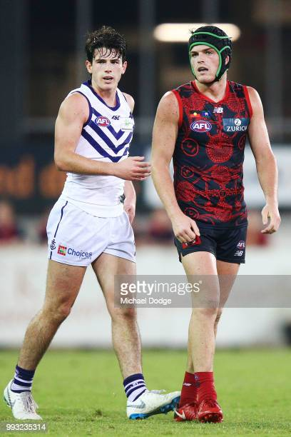 Andrew Brayshaw of the Dockers looks on with brother Angus Brayshaw of the Demons after their wrestle during the round 16 AFL match between the...