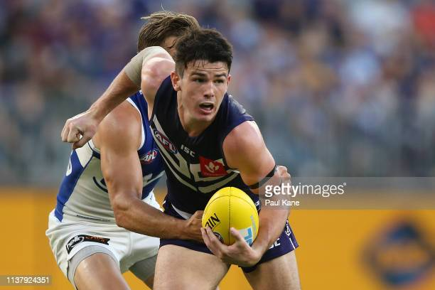 Andrew Brayshaw of the Dockers looks to handball during the round one AFL match between the Fremantle Dockers and the North Melbourne Kangaroos at...