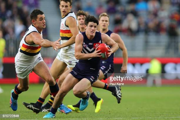 Andrew Brayshaw of the Dockers looks to pass the ball during the round 12 AFL match between the Fremantle Dockers and the Adelaide Crows at Optus...
