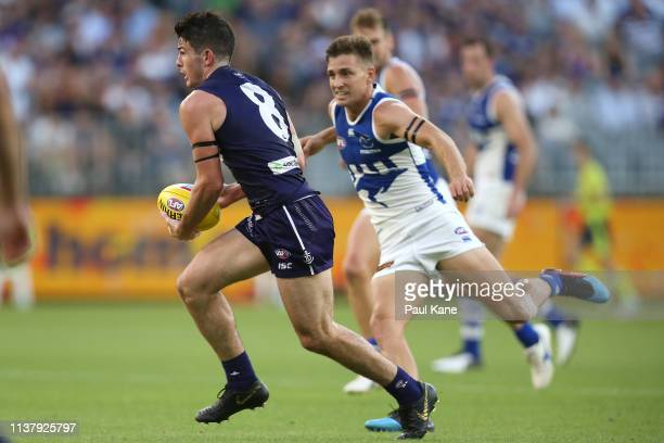 Andrew Brayshaw of the Dockers looks to pass the ball during the round one AFL match between the Fremantle Dockers and the North Melbourne Kangaroos...