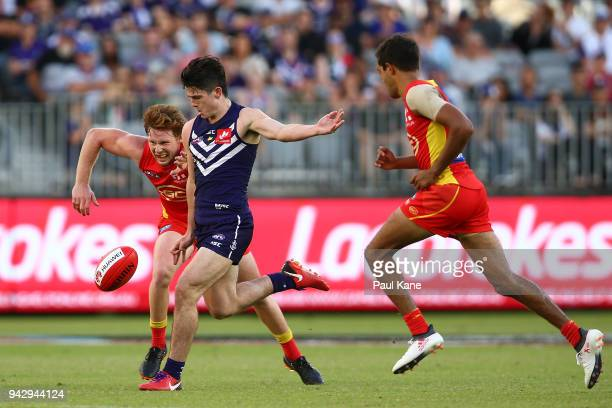 Andrew Brayshaw of the Dockers passes the ball during the round three AFL match between the Gold Coast Suns and the Fremantle Dockers at Optus...