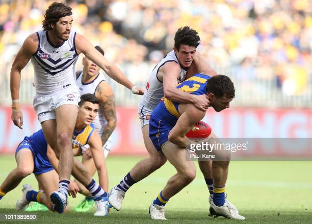 Andrew Brayshaw of the Dockers tackles Luke Shuey of the Eagles during the round 20 AFL match between the West Coast Eagles and the Fremantle Dockers...