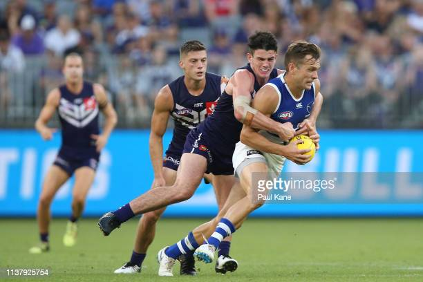 Andrew Brayshaw of the Dockers tackles Shaun Higgins of the Kangaroos during the round one AFL match between the Fremantle Dockers and the North...