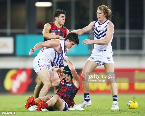 Andrew Brayshaw of the Dockers wrestles on top of brother Angus Brayshaw of the Demons after a contest during the round 16 AFL match between the...