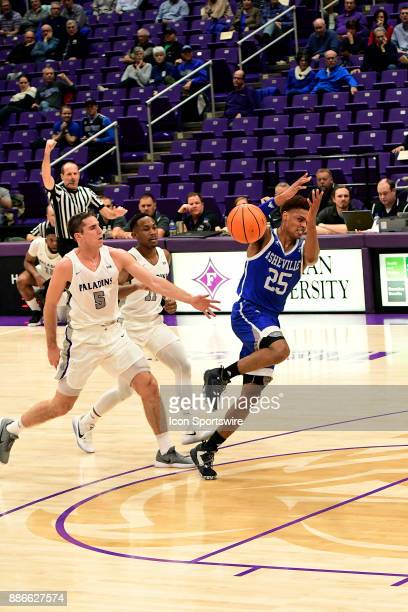 Andrew Brown guard Furman University Paladins is called for an intentional foul on MaCio Teague guard UNC Asheville Bulldogs Tuesday December 5 at...