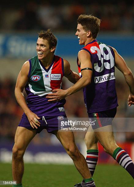 Andrew Browne and Daniel Haines for Fremantle celebrate a goal during the AFL game between the Fremantle Dockers and the Melbourne Demons at Subiaco...