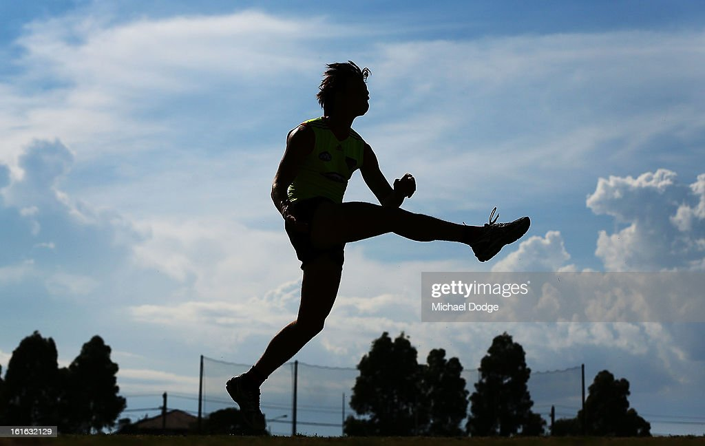 Andrew Browne kicks the ball during a Essendon Bombers AFL training session at Windy Hill on February 14, 2013 in Melbourne, Australia.