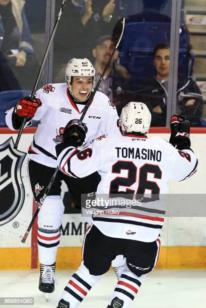 Andrew Bruder of the Niagara IceDogs celebrates a goal with Philip Tomasino during an OHL game against the Oshawa Generals at the Meridian Centre on...