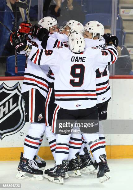 Andrew Bruder of the Niagara IceDogs celebrates a goal with teammates during an OHL game against the Oshawa Generals at the Meridian Centre on...