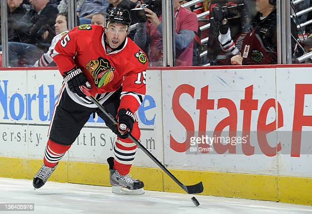 Andrew Brunette of the Chicago Blackhawks approaches the puck during the NHL game against the Detroit Red Wings on December 30 2011 at the United...